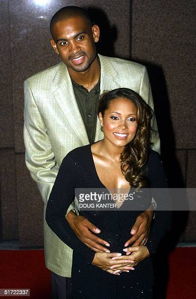 NBA basketball star Grant Hill of the Orlando Magic and his pregnant wife Tamia arrive for the Michael Jackson concert at Madison Square Garden in...