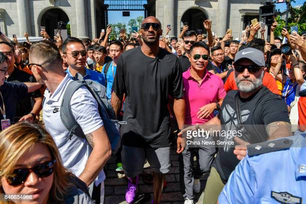 Basketball star Kobe Bryant is surrounded by fans during his China tour on September 12, 2017 in Haikou, Hainan Province of China.
