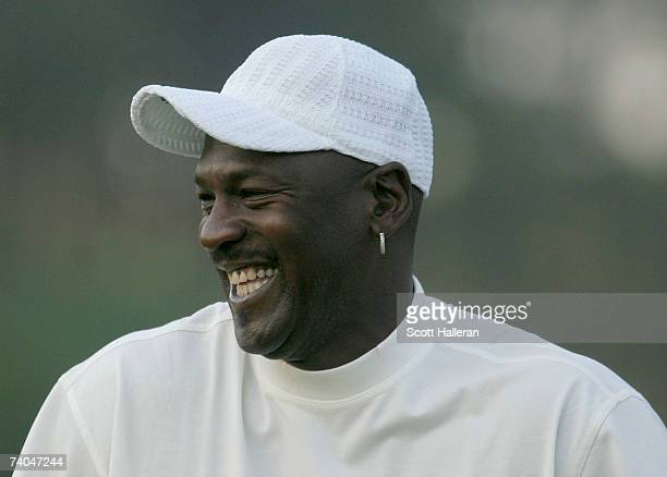 Basketball star Michael Jordan laughs on the first tee during the proam at the Wachovia Championship at Quail Hollow Country Club on May 2 2007 in...