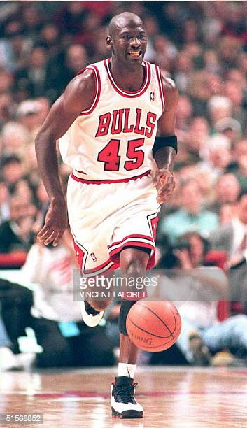 Basketball star Michael Jordan of the Chicago Bulls grimaces during the second quarter at the United Center in Chicago 24 March during a game against...