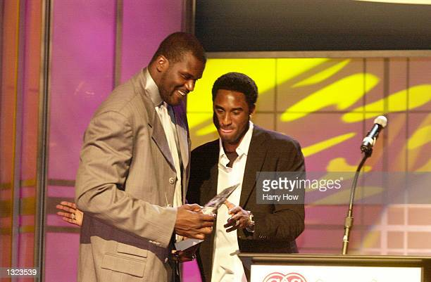 Basketball stars Kobe Bryant right presents Shaquille O''Neal an award during the 16th annual CedarsSinai Sports Spectacular Banquet at the Century...
