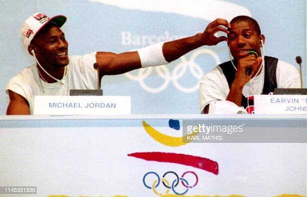 """Basketball stars Michael Jordan and Earvin """"Magic"""" Johnson clown for the media 25 July during a press conference for the U.S. Olympic """"Dream Team.""""..."""