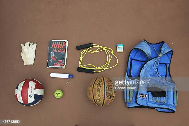 Still life portrait of objects used by SI Writer Michael McKnight during his practice sessions clockwise from top left a glove the book Jump Attack...