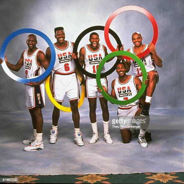 Basketball Summer Games Preview Portrait of Team USA Michael Jordan Patrick Ewing Magic Johnson Karl Malone and Charles Barkley with olympic rings...
