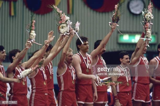 Summer Olympics USSR Arvydas Sabonis victorious with teammates on platform wearing gold medals after winning Men's Final vs Yugoslavia at Jamsil...