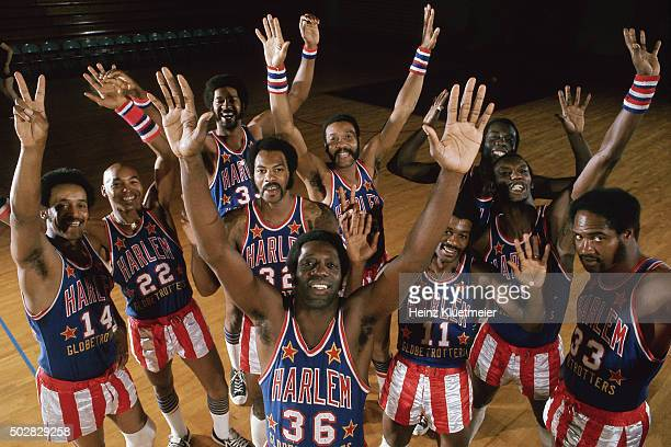 Team portrait of Harlem Globetrotters Meadowlark Lemon and teammates posing for group photo before game vs New York Nationals at Palais des Sports...