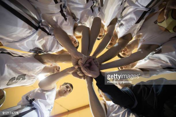 basketball team stacking - basketball team stock pictures, royalty-free photos & images
