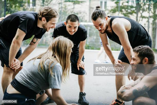 Basketball Teammates Discussing Game Plan Together Before Playing