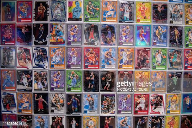 Basketball trading cards are displayed at the NBA exhibition in Beijing on August 19, 2019. - The Basketball world cup will be held from August 31 to...