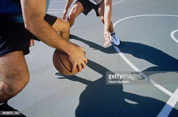 basketball, two men playing one-on- one, close-up of shadows on court - dribbling stock pictures, royalty-free photos & images