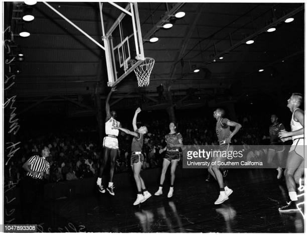 Basketball -- UCLA versus Saint Marys, 6 December 1957. 'Sports'. ;Caption slip reads: 'Photographer: Rustan. Date: . Assignment: Basketball -- UCLA,...
