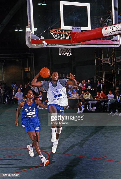 US Olympic Trials Georgetown Patrick Ewing in action dunk vs Oregon State AC Green during scrimmage at IU Fieldhouse on Indiana University campus...