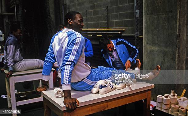 US Olympic Trials North Carolina Michael Jordan gets his feet wrapped by trainer after scrimmage at IU Fieldhouse on Indiana University campus...