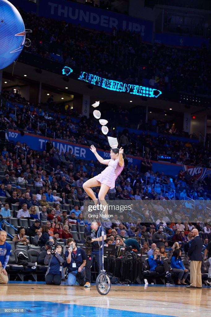 View of acrobat on unicycle balancing bowls on head during halftime of Oklahoma City Thunder vs Cleveland Cavaliers game at Chesapeake Energy Arena. Greg Nelson TK1 )