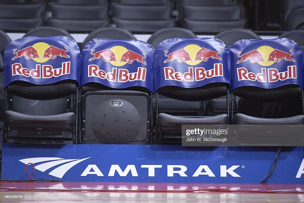 View Of Empty Courtside Seats With Red Bull Logo And Floor