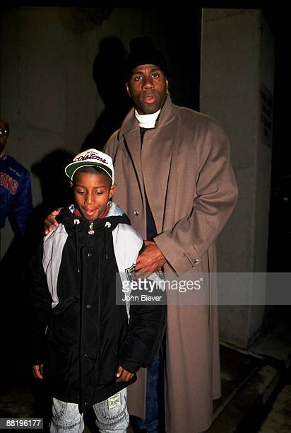 View of former Los Angeles Lakers Magic Johnson with son Andre Johnson before Detroit Piston vs Atlanta Hawks game Auburn Hills MI CREDIT John Biever