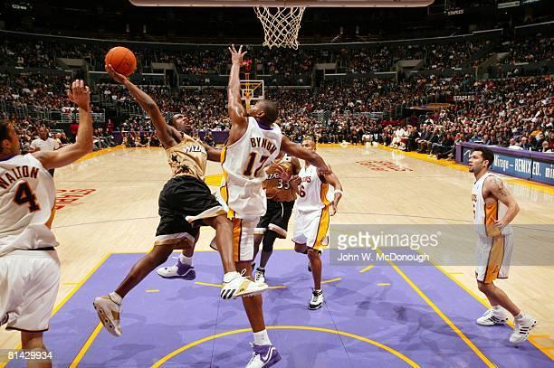 Basketball Washington Wizards Gilbert Arenas in action taking shot vs Los Angeles Lakers Andrew Bynum Arenas scored 60 points vs Lakers Los Angeles CA