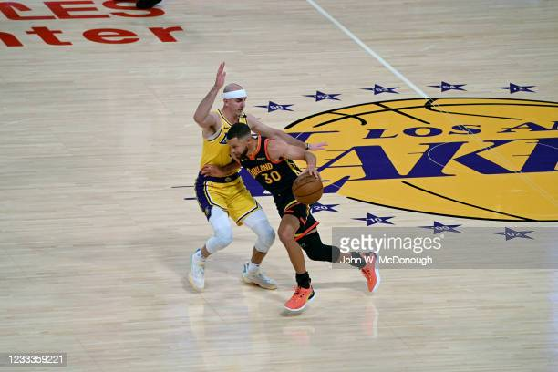 West PlayIn: Golden State Warriors Stephen Curry in action vs Los Angeles Lakers Alex Caruso at Staples Center. Game 1. Los Angeles, CA...