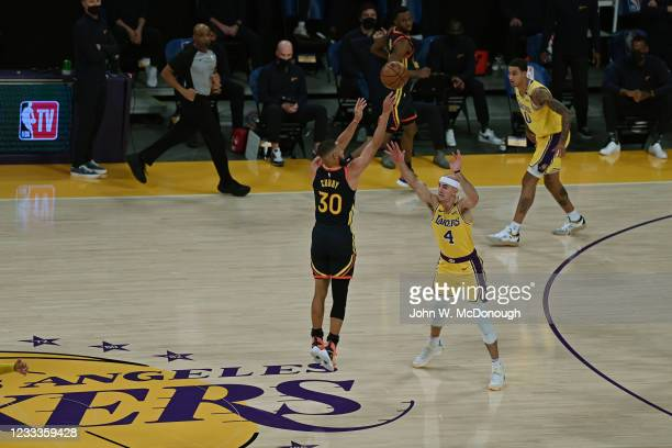 West PlayIn: Golden State Warriors Stephen Curry in action, shooting vs Los Angeles Lakers Alex Caruso at Staples Center. Game 1. Los Angeles, CA...