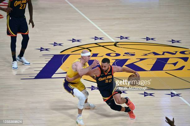 West PlayIn: Golden State Warriors Stephen Curry in action vs Los Angeles Lakers Alex Caruso at Staples Center. Game 1. Los Angeles, CA 5/19/2021...