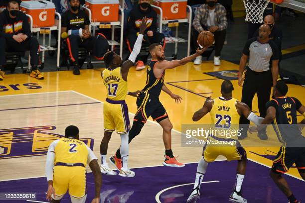 West PlayIn: Golden State Warriors Stephen Curry in action vs Los Angeles Lakers Dennis Schroder at Staples Center. Game 1. Los Angeles, CA...