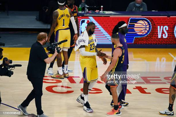 West PlayIn: Los Angeles Lakers LeBron James shaking hands with Golden State Warriors Stephen Curry after game at Staples Center. Game 1. Los...