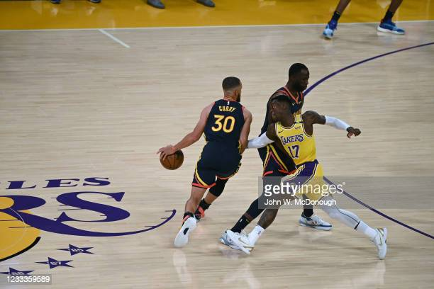 West PlayIn: Rear view of Golden State Warriors Stephen Curry in action vs Los Angeles Lakers Dennis Schroder at Staples Center. Game 1. Los Angeles,...