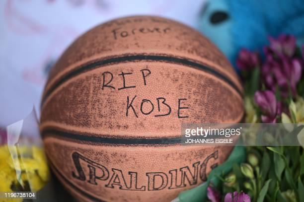 A basketball with a message to Kobe Bryant is seen between memorial flowers outside Bryant Gymnasium at Lower Merion High School where basketball...