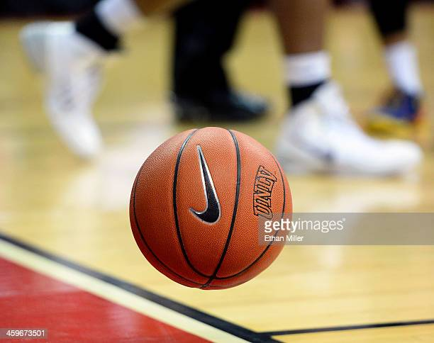 A basketball with a Nike logo bounces on the court during a game between the California State Fullerton Titans and the UNLV Rebels at the Thomas Mack...