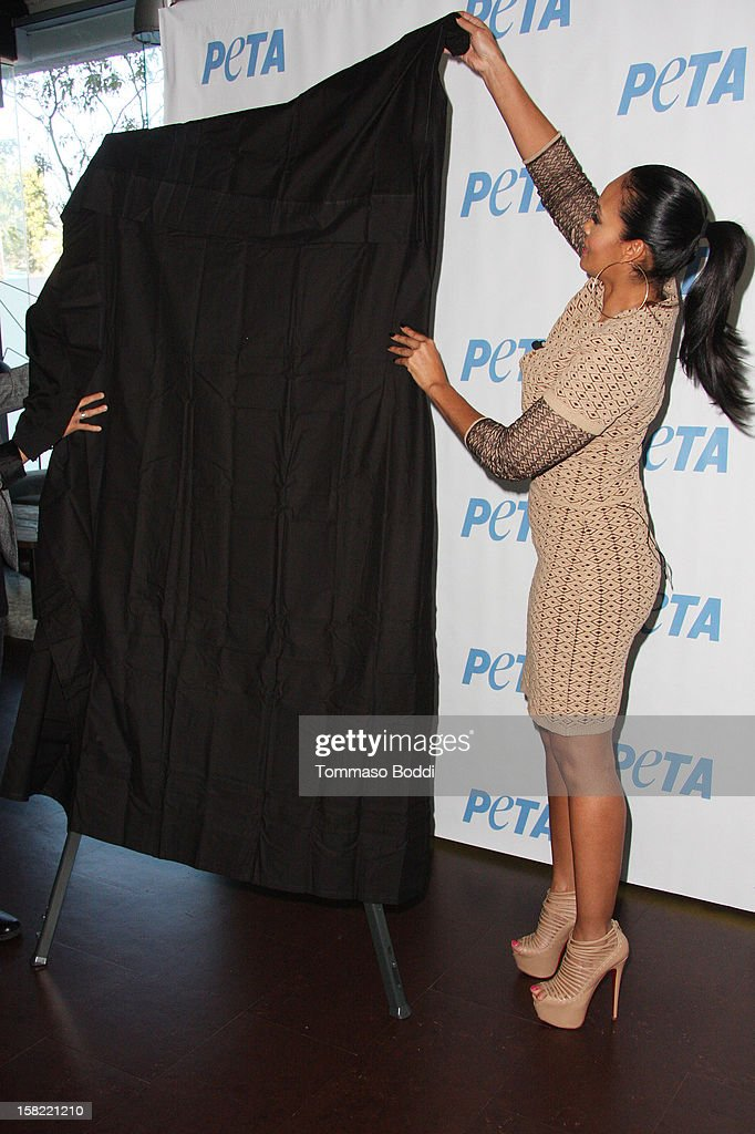 'Basketball Wives' Evelyn Lozada unveils her 'Cheeky' new winter-themed naked anti-fur ad for PETA held at the Bob Barker building on December 11, 2012 in Los Angeles, California.