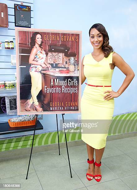 Basketball Wives star Gloria Govan poses for a photo at her book signing at JuiceCJuice Books More on September 15 2013 in Carson California