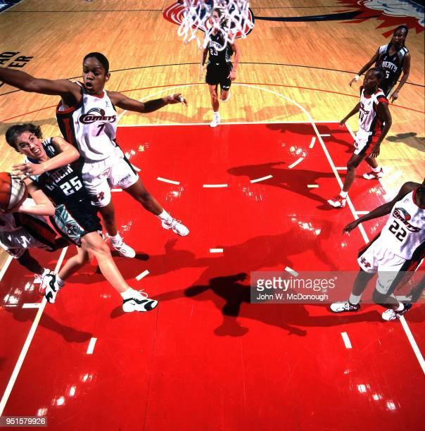WNBA Finals New York Liberty Becky Hammon in action during Game 3 vs Houston Comets Tina Thompson at Compaq Arena Houston TX CREDIT John W McDonough