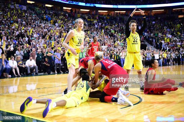 WNBA Finals Seattle Storm Alysha Clark signalling for time out during battle for loose ball as Breanna Stewart looks on vs Washington Mystics at Key...
