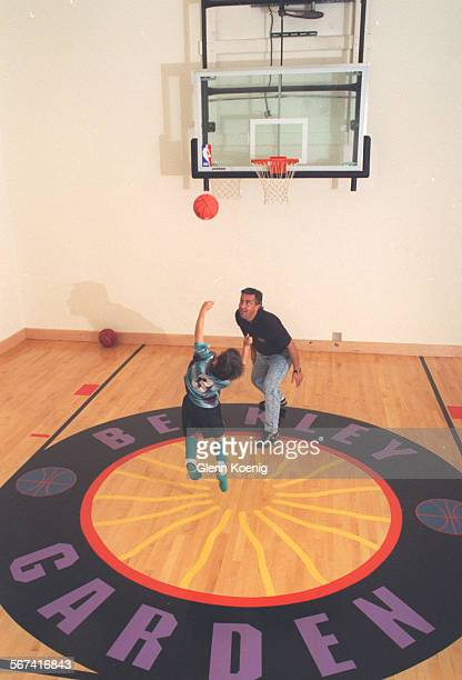 LSBasketball/Court1026GK–Jeffrey Berkley and his son Eric Berkle y age 7 as they go one on one at the basketball court at the home of Jeffrey and...