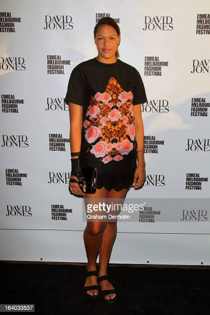 Basketballer Liz Cambage poses as she arrives for the L'Oreal Melbourne Fashion Festival Opening Event presented by David Jones at Docklands on March...