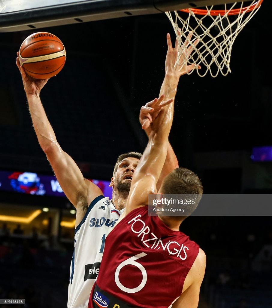 Basketballer of Slovenia in action against Kristaps Porzingis (6) of Latvia during the FIBA Eurobasket 2017 quarter final basketball match between Slovenia and Latvia at the Sinan Erdem Sport Arena in Istanbul on September 12, 2017.