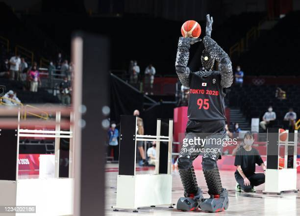 Basketball-playing robot named CUE plays basketball during half-time of the Men's Preliminary Round Group B game between the United States and France...