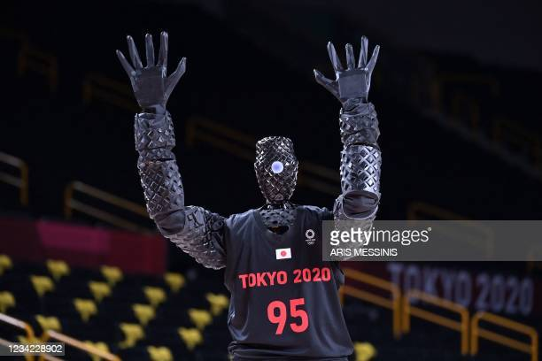 Basketball-playing robot named CUE plays basketball during half-time of the women's preliminary round group C basketball match between Australia and...