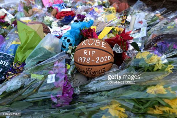 Basketballs are seen outside Bryant Gymnasium at Lower Merion High School where basketball legend Kobe Bryant formally attended school after his...