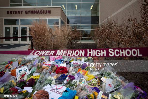 Basketballs flowers letters and jerseys are left at a memorial for former Los Angeles Laker Kobe Bryant after he was killed in a helicopter crash at...