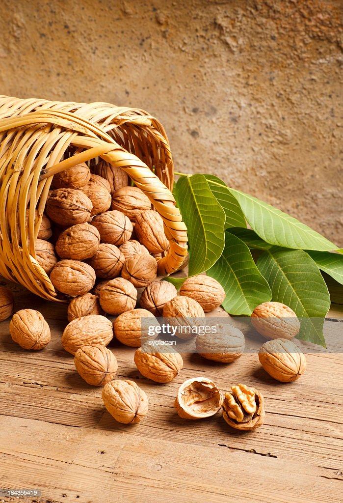 Basketful of walnuts : Stock Photo
