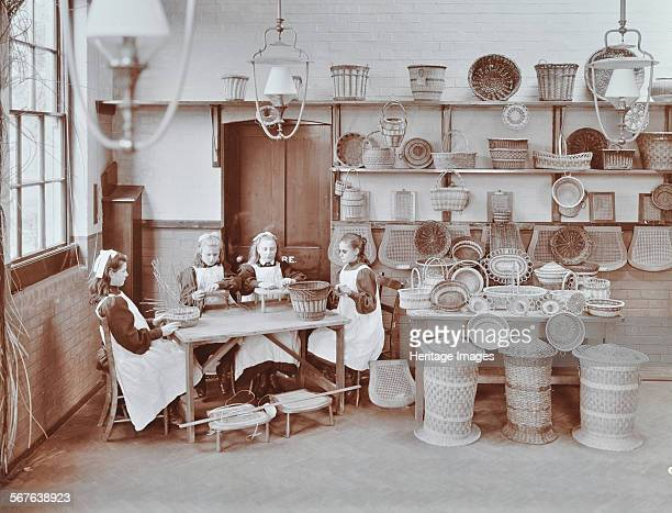 Basketry workshop at Elm Lodge Residential School for Elder Blind Girls, West Norwood, Lambeth, London, 1908. Girls work at making baskets, with...