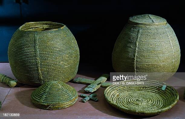 Baskets and support plate ca 1450 BC woven palm leaves from the western cemetery of Qurnet Murai Egyptian civilisation New Kingdom Dynasty XVIII...