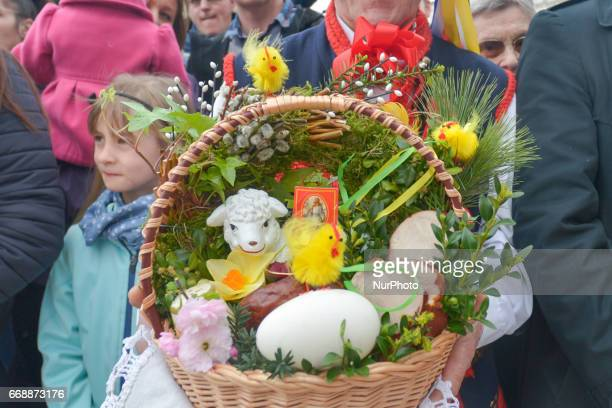 Baskets containing a sampling of Easter foods are brought outside Mariacki Basilica in Krakow to be blessed on Holy Saturday by the Archbishop of...