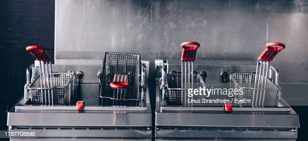 baskets in containers at restaurant - fast food restaurant stock pictures, royalty-free photos & images