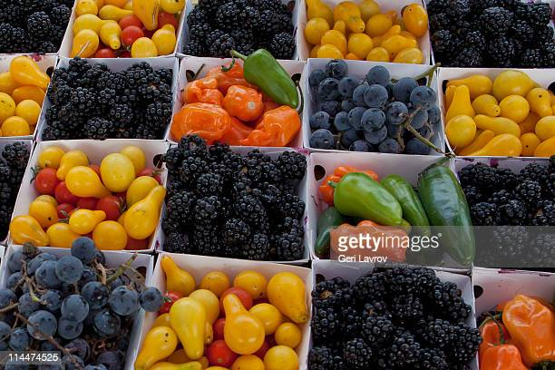 Baskets of blackberries,tomatoes,peppers,grapes