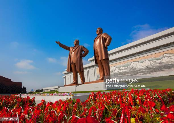 Baskets of flowers in front of the two statues of the Dear Leaders in the Grand monument on Mansu hill Pyongan Province Pyongyang North Korea on...