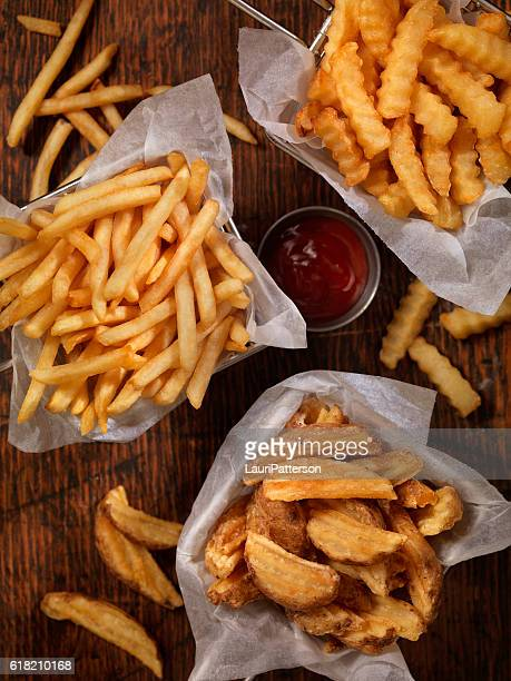 baskets of french fries - fries imagens e fotografias de stock