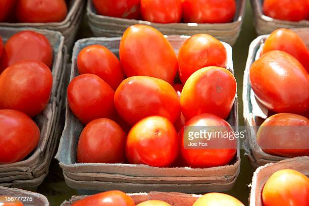 Baskets of fresh plum tomatoes for sale
