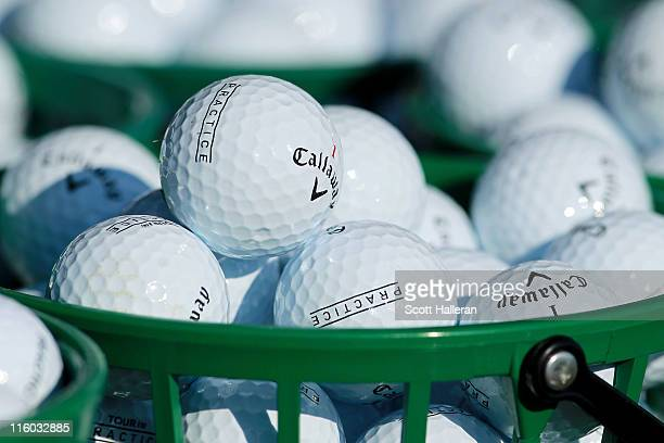 Baskets of golf balls sit on the practice range during a practice round prior to the start of the 111th US Open at Congressional Country Club on June...
